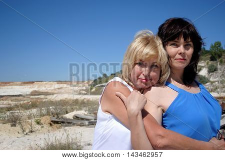 Two women of different ages stood in front of a chalk quarry. Blonde and brunette, mother and daughter, the succession of generations.