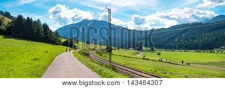 mountain landscape with railroad and bike path