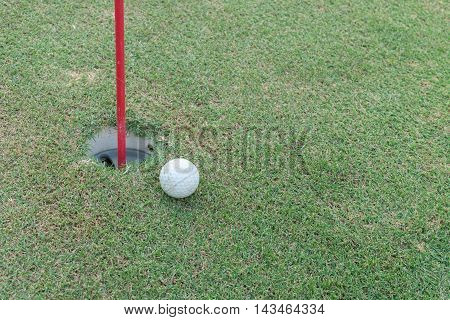 Golf Ball Lip Of Hole On Green