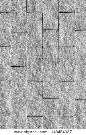 The gray cement brick wall background .