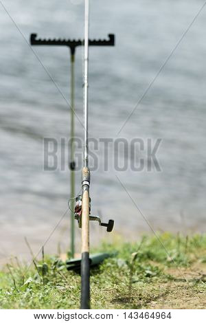 Fishing The Feeder On Background Of River And Shore