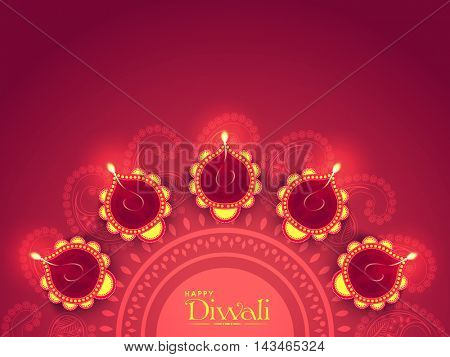 Illuminated Lit Lamps on beautiful floral Rangoli, Elegant Greeting Card, Creative Diwali Festive Background, Vector Illustration for Indian Festival of Lights Celebration.