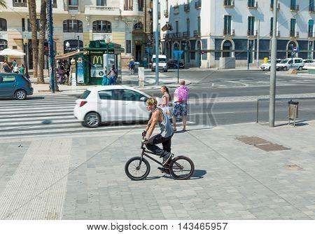 Alicante, Spain - SEPTEMBER 2015: Young man at Square 'Plaza Puerta del Mar' at summer day