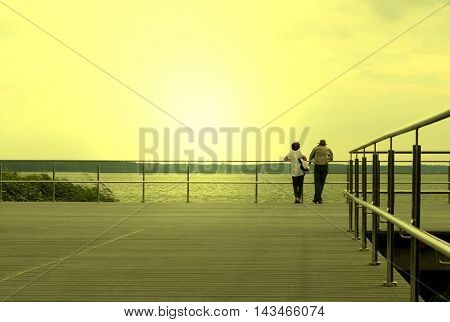 couple on the pier ; toned photo