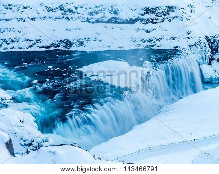 Gulfoss Waterfall of the Golden Circle in heavy snow in Iceland