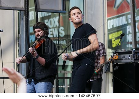 NEW YORK-JUL 31: Country music artist Scotty McCreery (R) performs at Fox and Friends' All-American Summer Concert Series on the corner of 48th Street and 6th Avenue on July 31, 2015 in New York City.