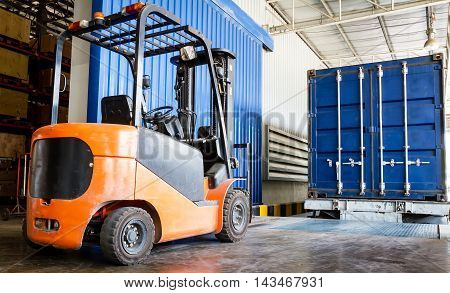 Forklift in warehouse with container at factory