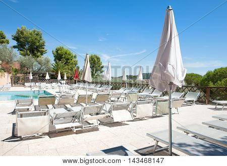 Comfortable Poolside Under The Sun