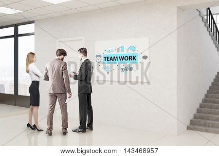 Group of people standing in lobby near team work poster discussing issues. Concept of brainstorming. 3d rendering
