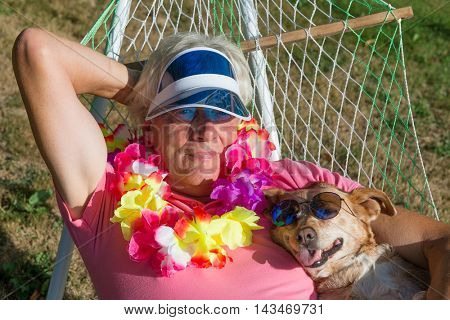 Man and dog resting in hammock