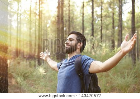 Happy Young Man Feeling The Forest