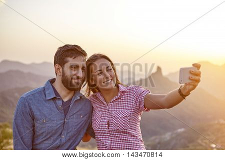 Young Couple On A Mountain Top