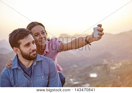 Happy Couple On A Mountain Top