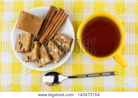 Pieces Of Sherbet, Sticks Of Cinnamon In Saucer, Cup Of Tea