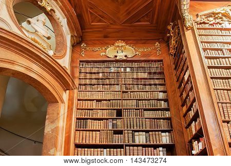 VIENNA, AUSTRIA - MAY 30, 2016: Wooden furniture and bookcase inside the building of the Austrian National Library on May 30, 2016. Est in 18th century the largest library in Austria with 7.4 mill items
