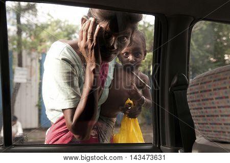 MUMBAI, MAHARASHTRA, INDIA - Jul 14 2010: Portrait of mother and daughter beggars on a Mumbai street.