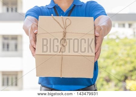Delivery man holding a parcel box. Delivery service concept