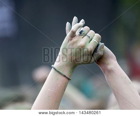Closeup of two hands holding each other in the air