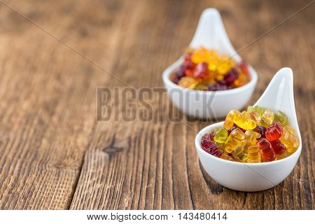 Wooden Table With Gummy Bears (selective Focus)