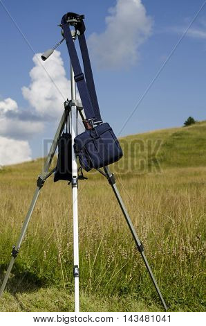 photo equipment hold on tripod in nature