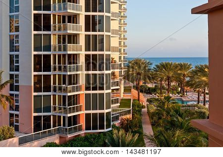 Miami USA - November 24 2011: View close to a modern luxury building and tropical beach in Miami