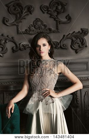 Fashion Girl with dark hair in Luxury Evening Gown