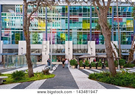 Miami USA - November 26 2011: People on L. Road Miami most famous shopping street at November 26 2011. The pedestrian mall pedestrian is considered the true heart and soul of South Beach in Miami Beach. No other avenue in the City is as popular 24 ho