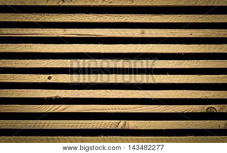 Background with wooden planks stack - Unique background with stacked wooden planks, wonderful details with wood knots and strong lines.