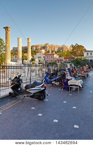 ATHENS, GREECE - AUGUST 20, 2016: Remains of Hadrian's Library, Plaka and Acropolis on a summer evening on August 20, 2016.