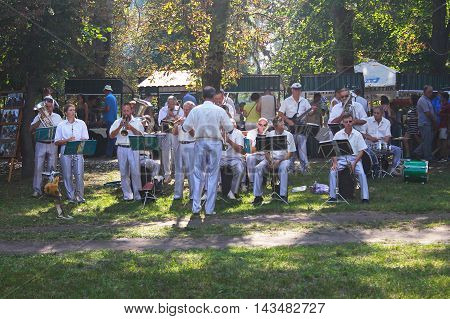 Myrgorod, Ukraine - August 20, 2016: Orchestra performs at festival of blacksmiths