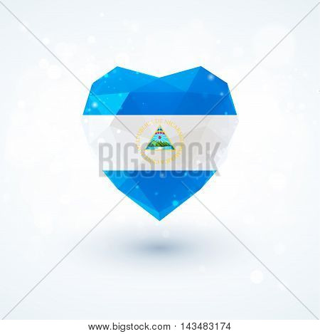 Flag of Nicaragua in shape of diamond glass heart in triangulation style for info graphics, greeting card, celebration of Independence Day, printed materialsFlag of Laos in shape of diamond glass heart in triangulation style for info graphics, greeting ca