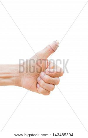 horizontal photo of closeup of farmer's hand showing thumbs up with bandage isolated on white background clipping path