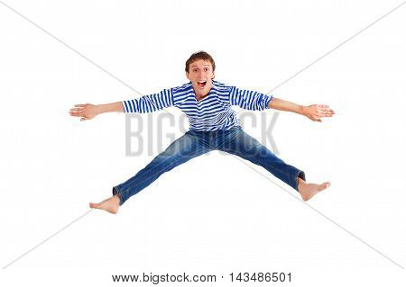 funny guy jumped up isolated on white. cheerful young man jumping. man dressed in a striped sweater and jeans. isolated on white background
