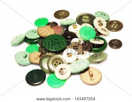 Sewing buttons on various colors, isolated on white background.