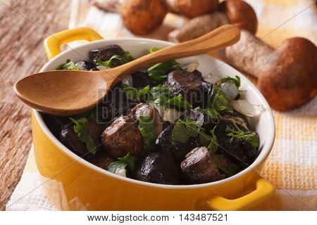 Fried Porcini Mushrooms And Onion Closeup. Horizontal