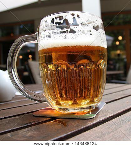 Beer mug on a restaurant table travel europe