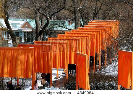 New York City - February 25 2005: Artist Christo's art installation The Gates winds through a snowy Central Park