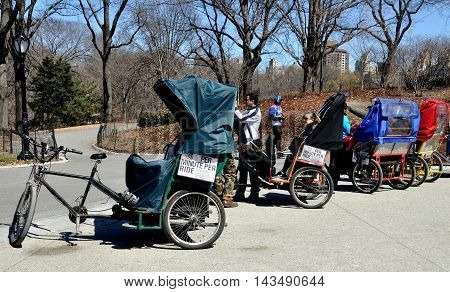 New York City - April 1 2014: A row of tourist pedicabs parked at Cherry Hill in Central Park