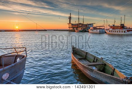Fishing boats and pleasure boats docked at harbor in Nida village, Curonian spit, Lithuania