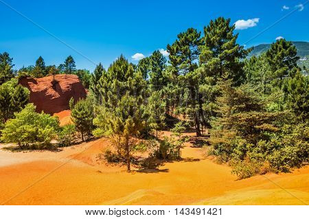 Picturesque orange-yellow hills of natural dye - ochre. The South of France, Languedoc - Roussillon