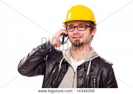 Handsome Young Man in Hard Hat Talking on Cell Phone Isolated on a White Background.