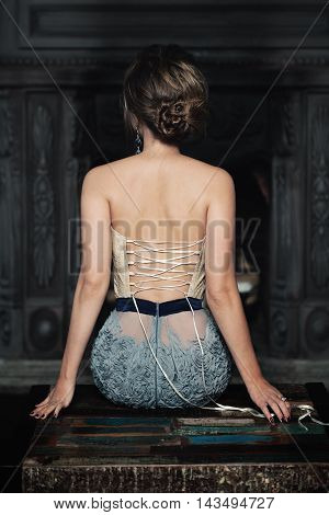 Sexy Fashion Model. Female Back on dark background