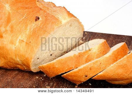 Fresh-sliced olive sourdough bread on a board, white background