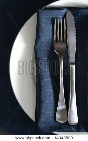 Place setting with blue napkin