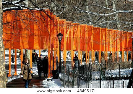 New York City - February 25 2005: Orange fabric panels hang from Christo's public art installation The Gates in Central Park