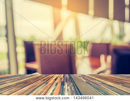 Blur Image Of Empty Restaurant With Wood Table And Chairs.