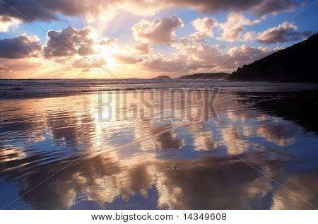 Whisky Beach, Wilson's Promontory, Australia, with sunset clouds reflected in the shallows