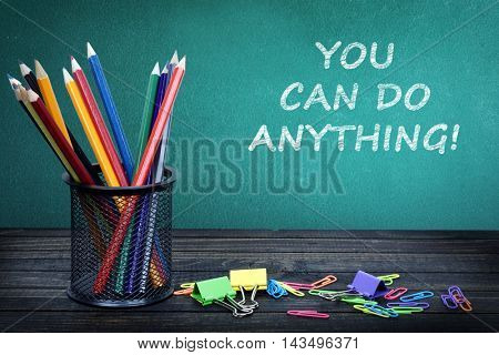 You can do anything text on green board and group of pencils