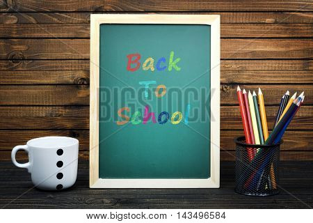 Back to School text on school board and group of pencils