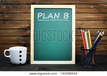 Plan B text on school board and group of pencils